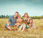Parents and two daughters with dog Stock Photos