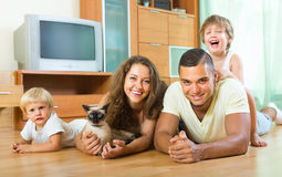 Parents and two daughters with Siamese. Portrait of happy smiling parents and two daughters with Siamese at home Stock Images