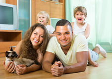 Parents and two daughters with Siamese Stock Image