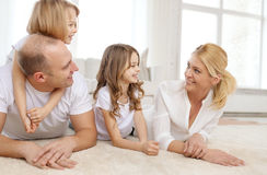 Parents and two girls lying on floor at home Royalty Free Stock Photo