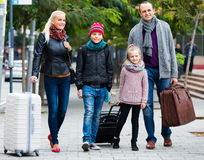 Parents with two kids chasing streets Royalty Free Stock Photos