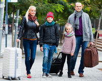 Parents with two kids  chasing streets Stock Photography
