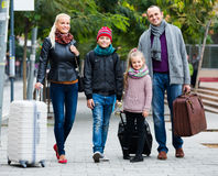 Parents with two kids chasing streets Stock Photos