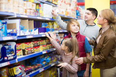 Parents with two kids choosing crispy flakes in shop Royalty Free Stock Photography