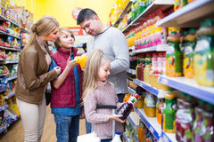 Parents with two kids choosing  juice Stock Photography