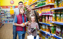 Parents with two kids choosing soda Stock Photo