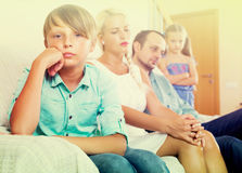 Parents and two kids in conflict at home. Sad tired parents and two kids in bad conflict at home Royalty Free Stock Photography