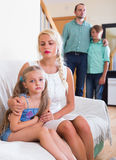 Parents and two kids in conflict at home. Tired parents and two kids in bad conflict at home. Selective focus on girl Royalty Free Stock Photography