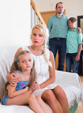 Parents and two kids in conflict at home. Unhappy parents and two kids in bad conflict at home. Focus on woman Royalty Free Stock Photography