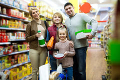 Parents with two kids holding purchases in store Stock Photos