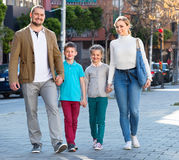 Parents with two teenagers going for shopping outdoors Royalty Free Stock Photos