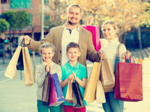 Parents with two teenagers going for shopping outdoors Stock Image