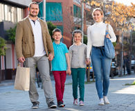Parents with two teenagers going for shopping outdoors Royalty Free Stock Image