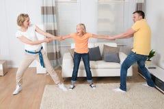 Parents under divorce dividing kids. At Home Royalty Free Stock Image