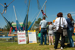 Parents Wait In Line With Kids For Bungy Ride Royalty Free Stock Photo