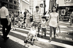 Parents walking the busy streets of new york. With children in their strollers Royalty Free Stock Photography