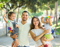 Parents walking with children Royalty Free Stock Image