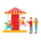 Parents Watching Kid Riding On Merry-Go-Round, Happy Family Having Good Time Together Illustration Stock Photography