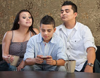 Parents Watching Teen Sending Messages Stock Images