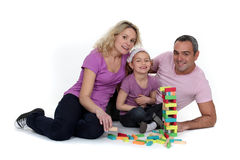 Parents watching their daughter play Stock Photo