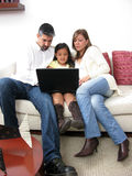 Parents whit son look on notebook Royalty Free Stock Photos