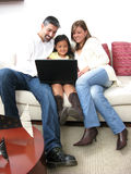 Parents whit son look on notebook Stock Photos