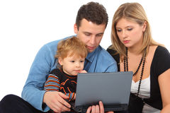 Parents whit son look on notebook Royalty Free Stock Image