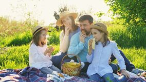 Free Parents With Daughters At Picnic On Lawn Eat Fruit Stock Photos - 183258493