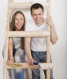 Parents With Their Son Near Ladder Stock Photography