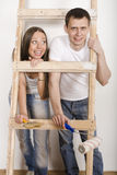 Parents With Their Son Near Ladder Royalty Free Stock Image