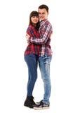 Pares adolescentes felizes no branco Fotografia de Stock