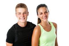 Pares adolescentes lindos en ropa de deportes Fotos de archivo libres de regalías