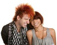 Pares adolescentes que ríen nerviosamente Fotos de archivo