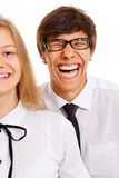 Pares adolescentes sonrientes divertidos Imágenes de archivo libres de regalías