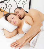 Pares adultos que duermen junto Imagen de archivo