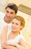 Pares amorous felizes em casa Imagens de Stock Royalty Free