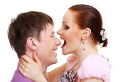 Pares aproximadamente para beijar-se Imagens de Stock Royalty Free