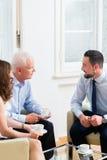Pares asesores del consejero financiero en planificación de la jubilación Foto de archivo