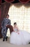 Pares asiáticos de la boda Imagen de archivo libre de regalías