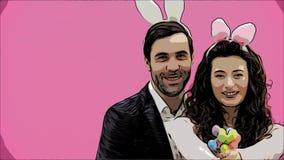 Pares atractivos jovenes en fondo rosado Con los oídos trillados en la cabeza Durante esto, el conejo salta reconstruye los movim