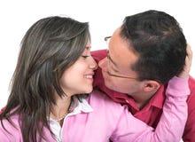 Pares bonitos aproximadamente a beijar Fotos de Stock Royalty Free