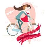 Pares cariñosos en la bicicleta. Tarjeta de felicitación del día de tarjeta del día de San Valentín. Foto de archivo