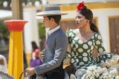 Pares a cavalo na feira Fotografia de Stock Royalty Free