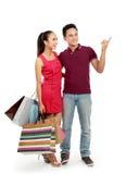 Pares com apontar dos sacos de compra Imagem de Stock Royalty Free
