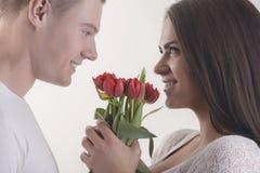 Pares com flores Imagens de Stock