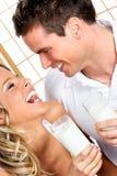 Pares com leite Fotografia de Stock Royalty Free