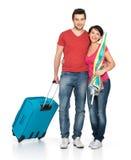 Pares com a mala de viagem que vai viajar Fotografia de Stock