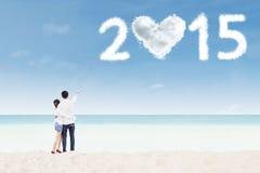 Pares com número dado forma nuvem 2015 fotografia de stock