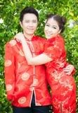Pares con el vestido del chino en amor Fotografía de archivo
