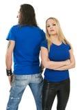 Pares con las camisas azules en blanco Imagen de archivo libre de regalías
